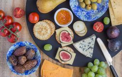 Cheese board with three cheeses, gouda with pimento, gouda with royalty free stock photography