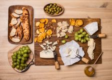 Cheese board. Various types of cheese. Cheese plate with cheeses Parmesan, Brie, Camembert and Roquefort serving on wooden board. Cheese board. Various types of royalty free stock images