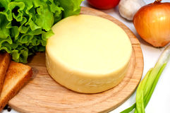 Cheese board with vegetables Stock Photography