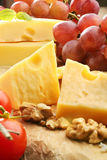 Cheese board yellow cheese composition Royalty Free Stock Photo