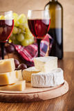 Cheese with a bottle and glasses of red wine Royalty Free Stock Photography