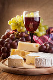 Cheese with a bottle and glasses of red wine Stock Photography
