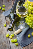 Cheese, a bottle of  wine with grape, walnut  and fig on old woo Stock Images