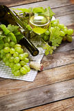 Cheese, a bottle of  wine with grape, walnut  and fig on old wood Stock Images