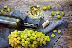 Cheese, a bottle of  wine with grape, walnut  and fig on old wood Stock Photos