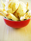 Cheese bread. In red bowl, wood background stock images
