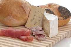 Cheese and bread Stock Images