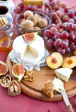 Cheese, bread and autumn fruit Royalty Free Stock Photos