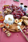 Cheese, bread and autumn fruit Royalty Free Stock Images