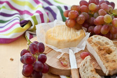 Cheese, bread and grapes Royalty Free Stock Photos