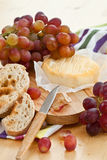 Cheese, bread and grapes Royalty Free Stock Image