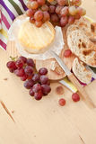 Cheese, bread and grapes Stock Images