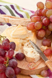 Cheese, bread and grapes Stock Photos
