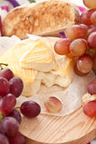 Cheese, bread and grapes Royalty Free Stock Images