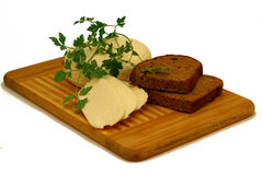 Cheese with bread and greenery Royalty Free Stock Photography