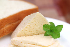 Cheese with bread and mint leaves Royalty Free Stock Photo