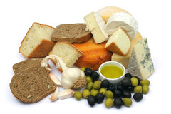Cheese, bread and olives. Mediterranean cheese with green and black olives, garlic and bread Stock Image