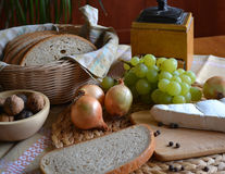 Cheese, bread, onions, wine and grinder Royalty Free Stock Photos