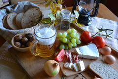 Cheese, bread, onions, wine, tomatoes and beer Royalty Free Stock Image
