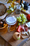 Cheese, bread, onions, wine, tomatoes and beer Stock Photo