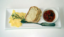 Cheese, bread and relish. Australian cheese on a plate with a tomato relish and bread Stock Photos