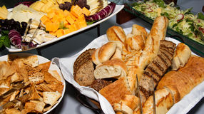 Cheese, bread, and salad party buffet Royalty Free Stock Image