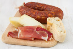 Cheese with bread, sausage Stock Photos
