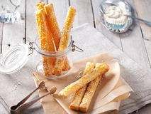 Cheese bread sticks with sesame seeds on a grey wooden background Royalty Free Stock Photography