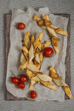 Cheese bread twisters and tomatoes Royalty Free Stock Image