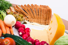 Cheese, bread and vegetable Stock Image