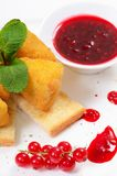 Cheese in breadcrumbs with currant jam Royalty Free Stock Images