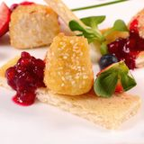 Cheese in breadcrumbs with currant jam Stock Photography