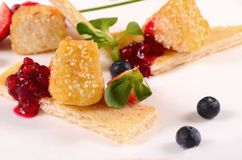 Cheese in breadcrumbs with currant jam Royalty Free Stock Image