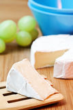 Cheese brie. Delicious cheese brie on a table royalty free stock image