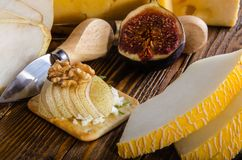 Cheese, bruschetta, fruit and honey. Tool for cheese. stock photos