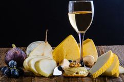 Cheese, bruschetta, fruit and honey. Tool for cheese. Wooden tab stock photos