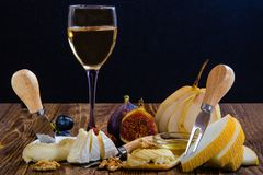 Cheese, bruschetta, fruit and honey. Tool for cheese. royalty free stock photo