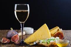Cheese, bruschetta, fruit and honey. Tool for cheese. stock image