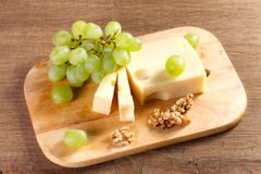 Cheese with brush of grapes and Stock Photos