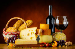 Cheese, Bun and Red Wine Stock Photography
