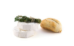 Cheese and a bundle of herbs Royalty Free Stock Photos