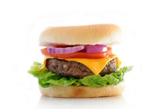 Cheese Burger. Roll with salad ingredients isolated over a white background royalty free stock images