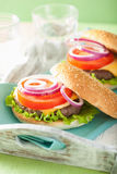 Cheese burger with beef patty lettuce onion tomato Royalty Free Stock Photos