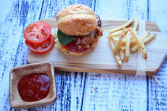 Cheese Burger French Fries and Ketchup straight horizontal Royalty Free Stock Photography