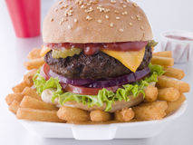 Cheese Burger In A Sesame Seed Bun With Fries Stock Image