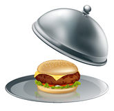 Cheese burger on silver platter. Illustration of a cheese burger on silver platter. Could be a concept for inflated worth or luxury burgers Stock Photography