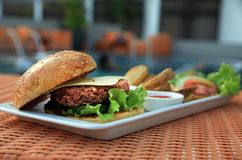 Cheese burger at swimming pool Royalty Free Stock Photography