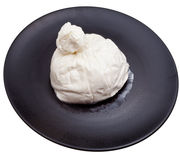 Cheese burrata on black ceramic plate Stock Photo