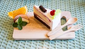 Cheesecake placed on a wooden plate. stock images