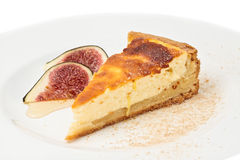 Cheese Cake. One slice of cheese cake served on a white plate with pulled figs Stock Photography